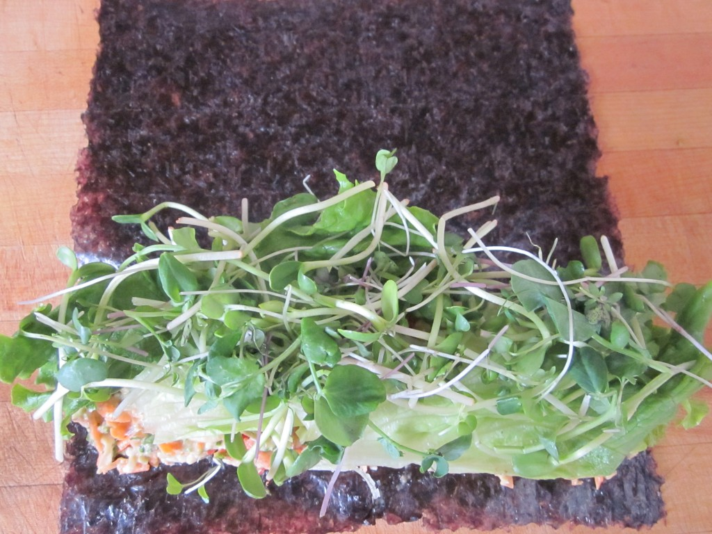 vegetables on nori sheets topped with lettuce and sprouts
