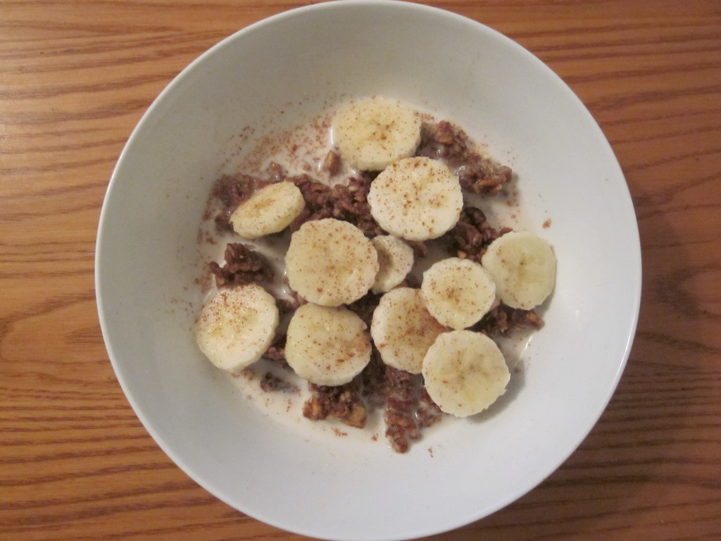 Granola with banana and almond milk in bowl