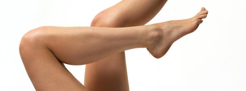 Bare Feet - Benefits of Barefoot Training - beuatuful long legs on a white background