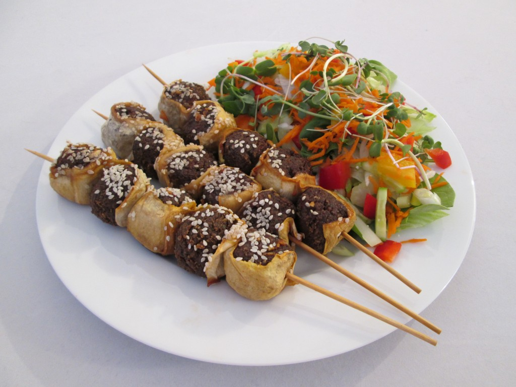 Zucchini and Nutmeat Skewers with Chili Garlic Sauce Recipe plated with salad